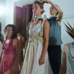 Anaya Fitting Neva with Cast Members in Background